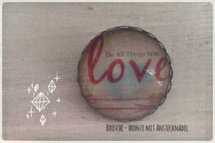 Brosche bronze mit Motiv Do all things with love